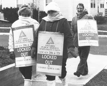Three OPSEU members protesting