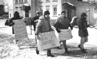 Five OPSEU members protesting