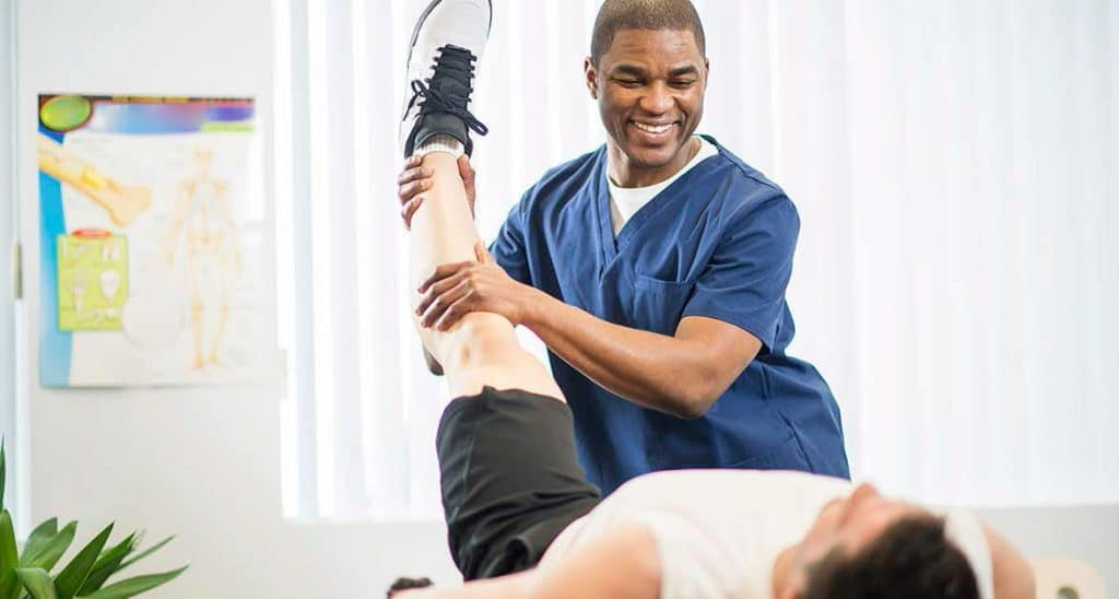 Male physiotherapist.