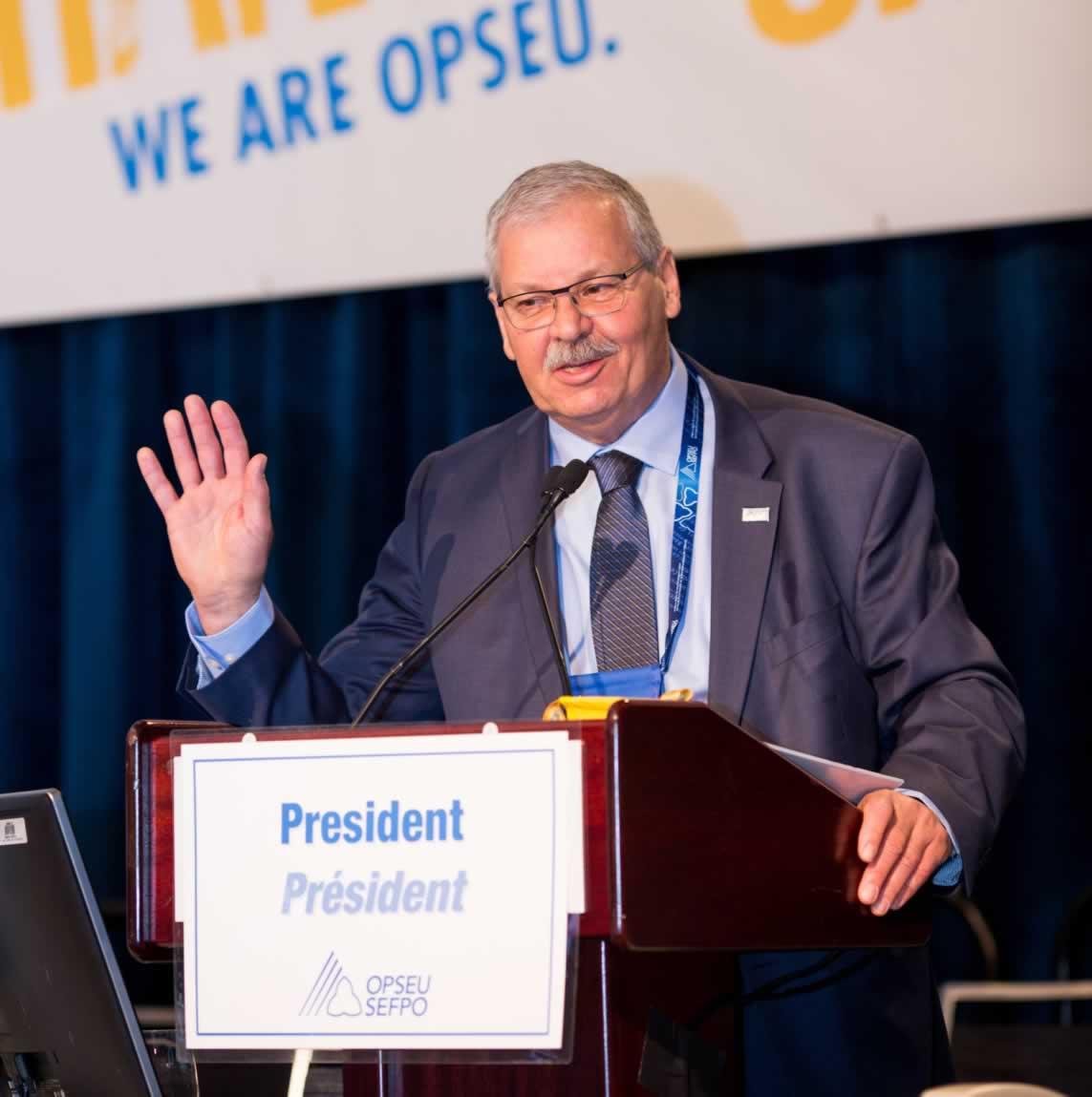 OPSEU President Warren Smokey Thomas speaking behind podium