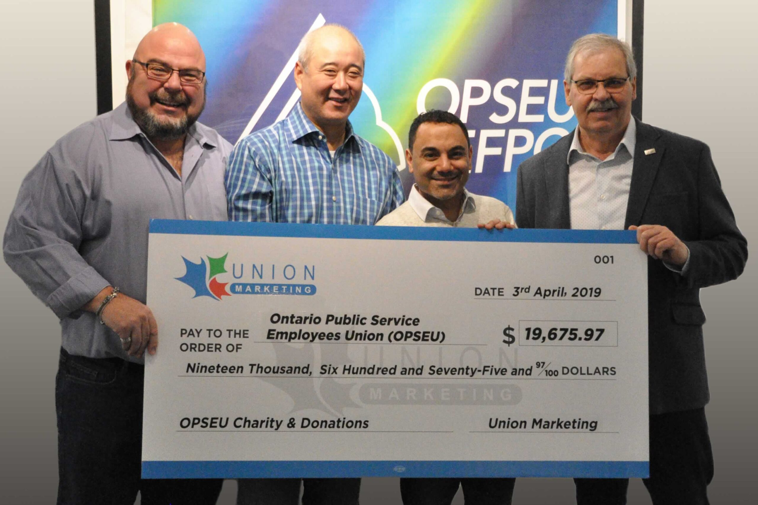 OPSEU President Warren (Smokey) Thomas and First Vice-President/Treasurer Eduardo (Eddy) Almeida accept a large donation cheque from representatives of Union Marketing.