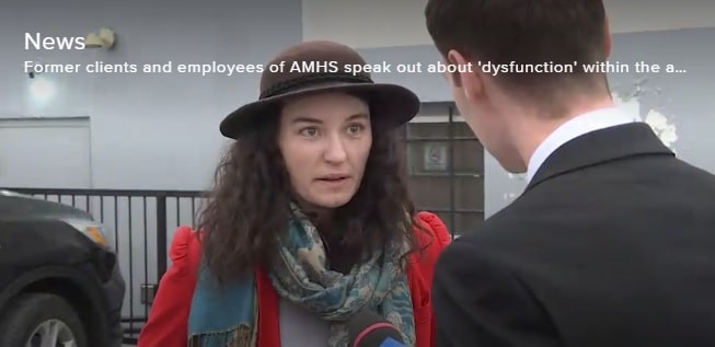 Woman being interviewed by a reporter about addictions and mental health services in the Kingston area.