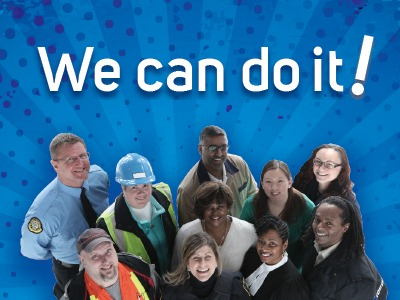 "Group of OPSEU members with the caption ""We can do it!"""