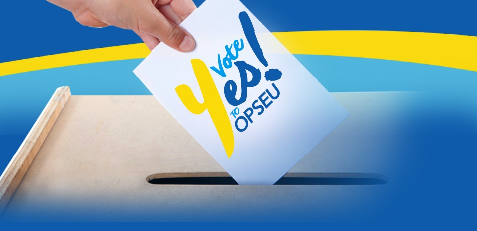 "Person putting a ballot that says ""Vote Yes to OPSEU!"" into a ballot box."