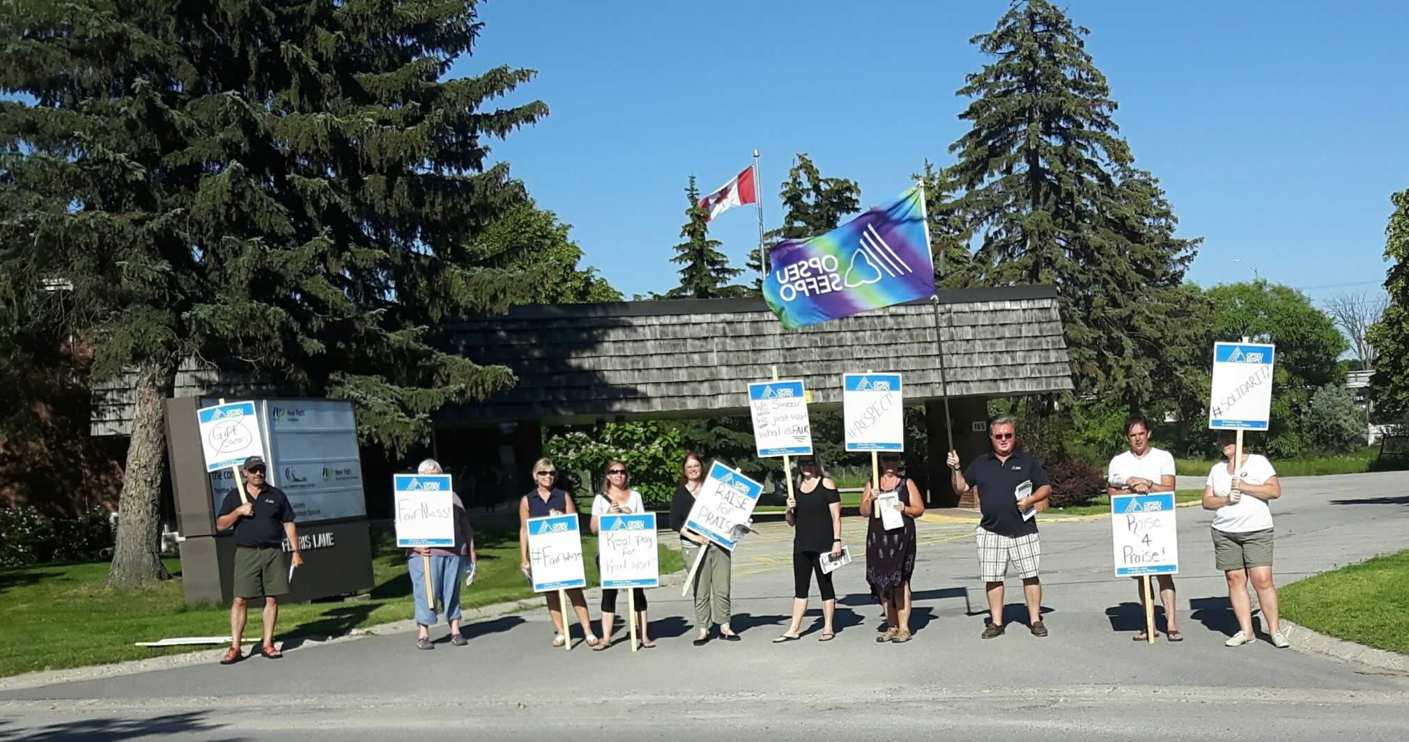 OPSEU members hold an information picket at New Path