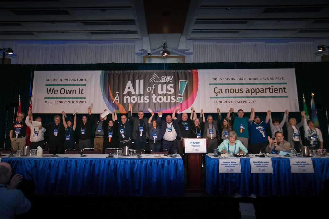 OPSEU's Executive Board hold hands up together during Convention 2017 Day 3