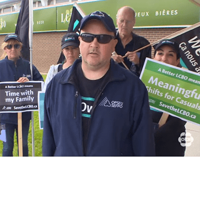 OPSEU members hold flags and signs during LCBO Information Picket