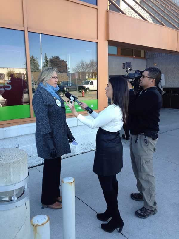 Denise Davis, Chair of the OPSEU Liqour Board Employees Division, speaks with the media