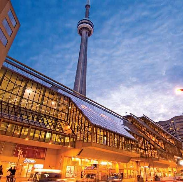 Metro Toronto Convention Centre (MTCC) at night with CN Tower in background.