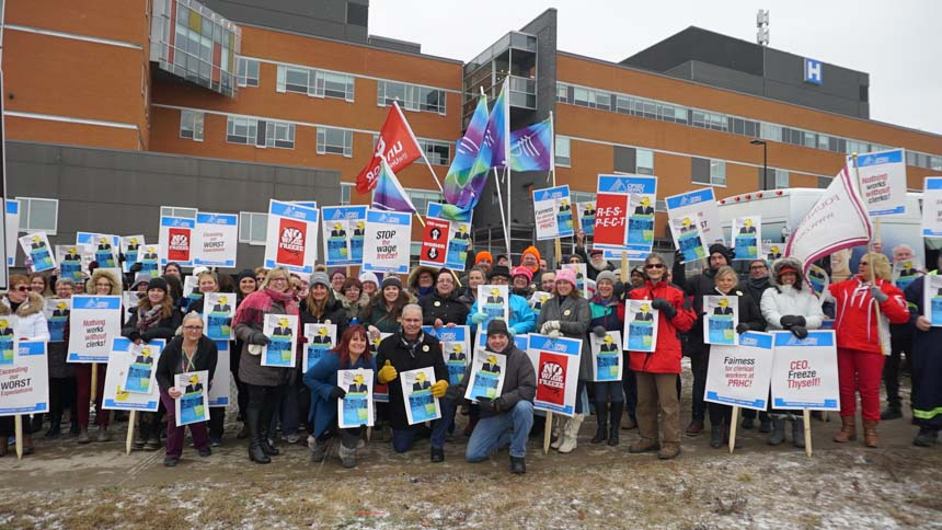 OPSEU President Warren (Smokey) Thomas with crowd of OPSEU members at Peterborough PHRC rally in December 11, 2018