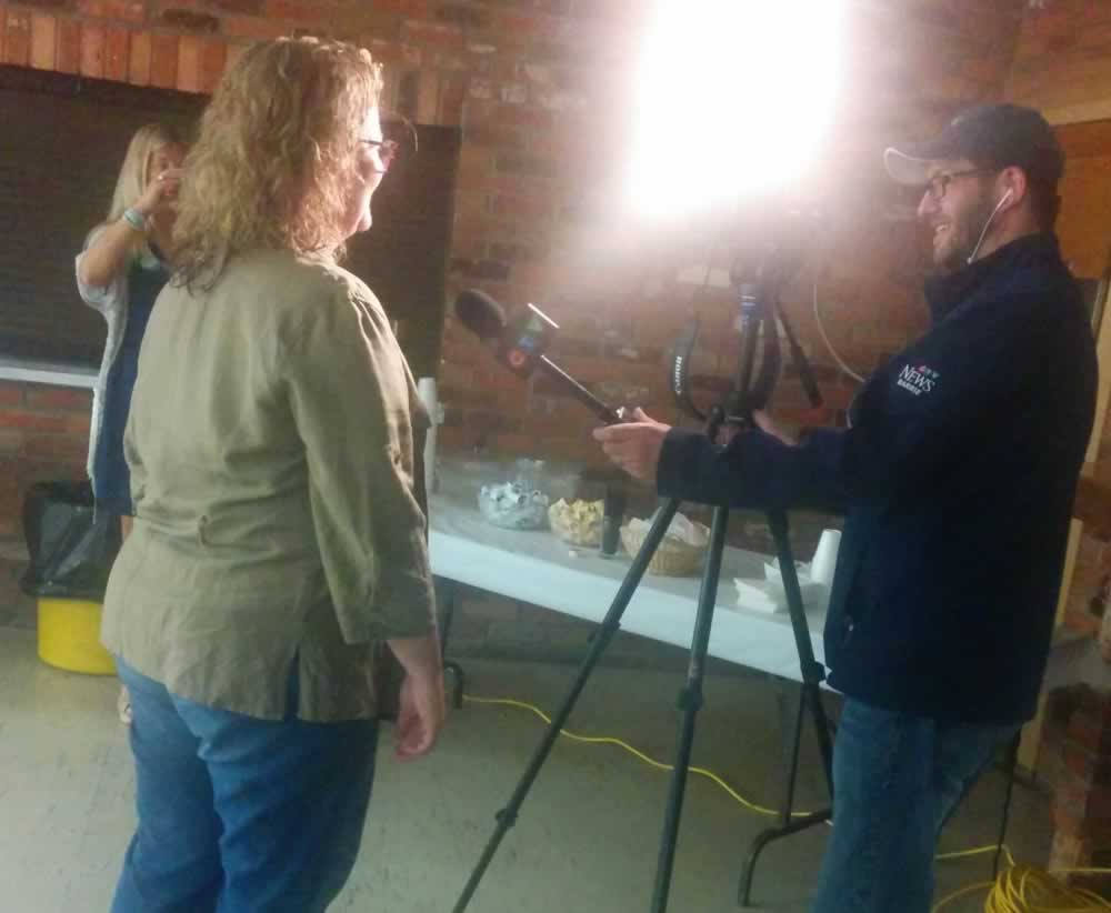 CTV reporter interviews a participant at the We Own It town hall meeting in Barrie