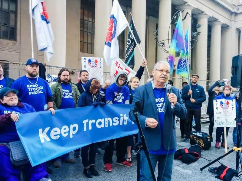 OPSEU President Warren (Smokey) Thomas speaks during the Keep Transit Public rally in Toronto.