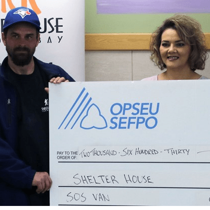 OPSEU local member presenting a cheque to Shelter House