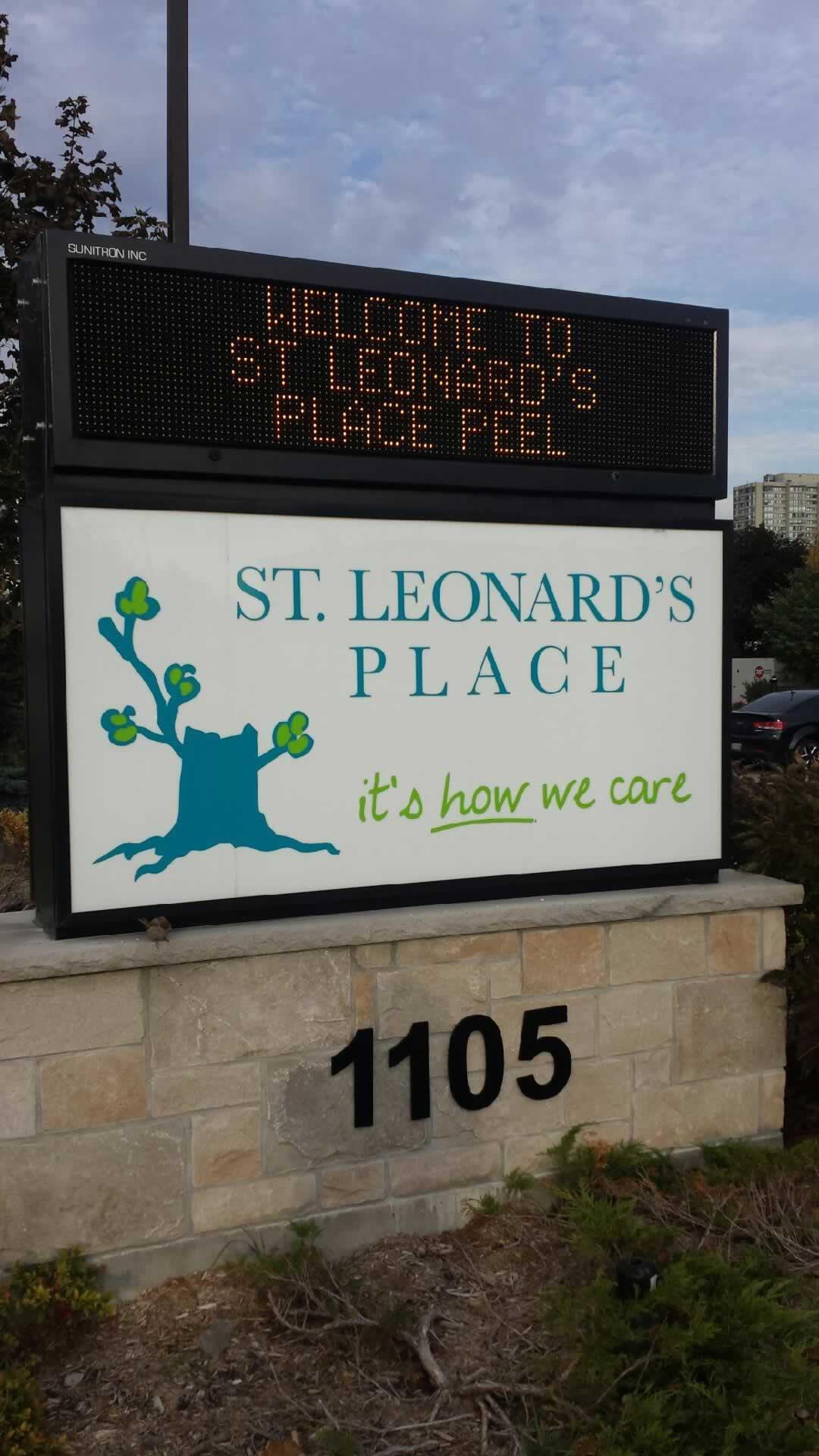 Outdoor sign that reads: St. Leonard's Place - it's HOW we care