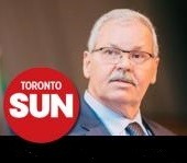 OPSEU President Warren (Smokey) Thomas with Toronto Sun logo