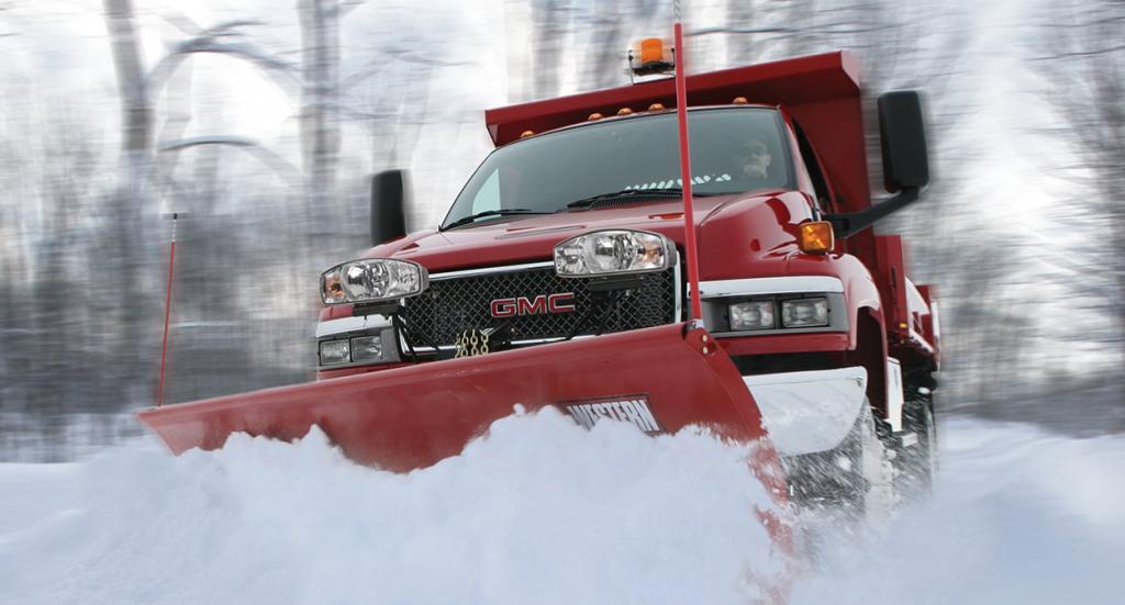 Snowplow in winter plowing snow