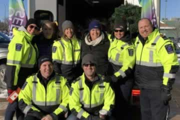 Group Photo of Local 462 Ambulance Communication Officers and Paramedics standing by ambulance